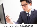 handsome businessman working... | Shutterstock . vector #264424832