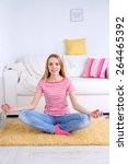 young woman doing yoga at home | Shutterstock . vector #264465392