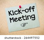 Small photo of Kick-off meeting Message. Recycled paper note pinned on cork board. Concept Image