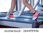 fit female legs on a treadmill...   Shutterstock . vector #264499946