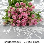 pink bouquet rose on lace   Shutterstock . vector #264511526