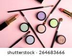 Stock photo set of decorative cosmetics on light colorful background 264683666