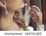 bride applying perfume  | Shutterstock . vector #264701285