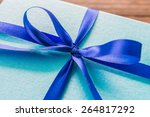 gift box on wood background  ... | Shutterstock . vector #264817292