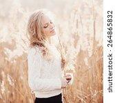 portrait of a beautiful blonde... | Shutterstock . vector #264865832
