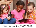 children learning to read with... | Shutterstock . vector #264896012