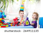 two happy child sitting at the... | Shutterstock . vector #264911135