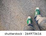 green sneakers shoes walking on ... | Shutterstock . vector #264973616