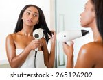 woman drying hair. rear view of ... | Shutterstock . vector #265126202