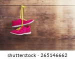 pair of sneakers hang on a nail ... | Shutterstock . vector #265146662