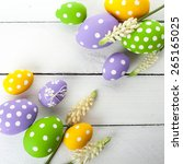 colorful easter eggs on white... | Shutterstock . vector #265165025