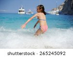 young girl playing in the wave... | Shutterstock . vector #265245092