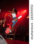 Small photo of BARCELONA - APR 1: Nkechi Ka Egenamba, rapper and the female lead vocalist for the indie band The Go! Team, jumps at Razzmatazz stage on April 1, 2011 in Barcelona, Spain.
