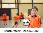 little boy holding football... | Shutterstock . vector #265368002