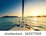 Nose of yacht sailing in the sea at sunset - stock photo