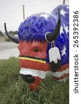 Small photo of American Buffalo & Bison painted with colors of U.S. Flag in South Dakota countryside