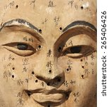Small photo of Ancient wooden face showing acupuncture points