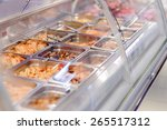 Stock photo cafeteria take out food in showcase window image of cooked snack bar meals in trays at display 265517312
