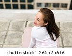 smiling asian girl on a rooftop ... | Shutterstock . vector #265525616