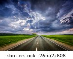 Travel concept background - road and stormy dramatic sky - stock photo