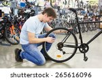 Man Checks A Bike Before Buyin...