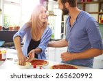 young couple making pizza in... | Shutterstock . vector #265620992
