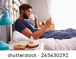 Man Eating Breakfast In Bed...