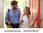 Young Woman Couple Home For...