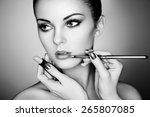 makeup artist applies lipstick. ... | Shutterstock . vector #265807085