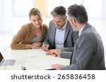 mature couple signing financial ... | Shutterstock . vector #265836458
