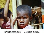 Stock photo very shy african boy with shadow on his face poverty in madagascar 265855202
