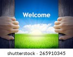 Welcome. Hands Opening A Wooden ...