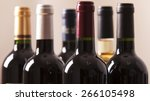 wine bottles in a row isolated... | Shutterstock . vector #266105498