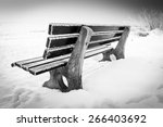 Bench  With Ice On Snowy Winte...
