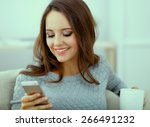 smiling woman sitting on sofa... | Shutterstock . vector #266491232