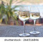 Two Glasses Of White Wine With...