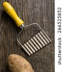 Small photo of close up of a hand crinkle cut potato chipper