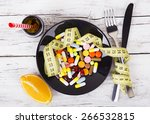 measuring tape and pills for... | Shutterstock . vector #266532815