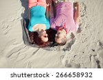 romantic young couple lying on... | Shutterstock . vector #266658932