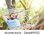 young caucasian man swinging in ... | Shutterstock . vector #266689532