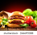 hamburger with fries on wooden... | Shutterstock . vector #266695388