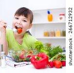 cute girl make vegetable salad | Shutterstock . vector #266712932
