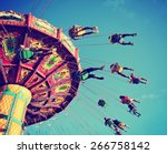 a swinging fair ride at dusk... | Shutterstock . vector #266758142