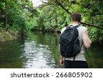 man trekking through jungle... | Shutterstock . vector #266805902