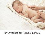 mother massaging infant boy | Shutterstock . vector #266813432