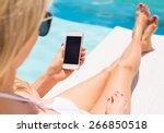 woman sunbathing in chair by... | Shutterstock . vector #266850518