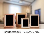photo frames on the wooden... | Shutterstock . vector #266939702