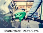 pumping gas at gas station.... | Shutterstock . vector #266973596