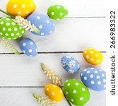 colorful easter eggs on white... | Shutterstock . vector #266983322