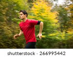 Young Man Running Outdoors In ...